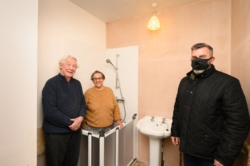 Mr and Mrs Buckley (left) in their new bathroom with David Catterall from 0800 Repair (right)